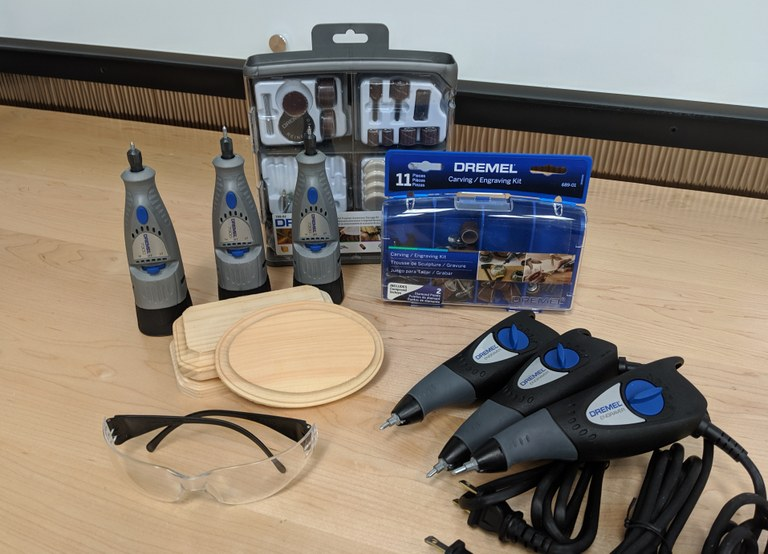 photo of engraving tools, including Dremel rotary tools and engravers